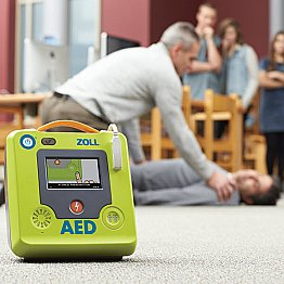 Man using Zoll AED Defibrillator